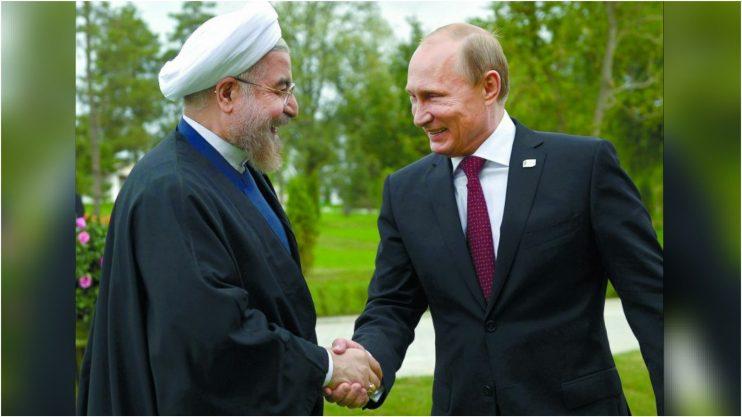 רק שאלה. ולדימיר פוטין וחסן רוחאני צילום AFP